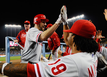 LOS ANGELES, CA - AUGUST 09:  Statrting pitcher Cliff Lee #33 of the Philadelphia Phillies is congratulated by Michael Martinez #19 after hitting a one-run home run off starting pitcher Ted Lilly #29 of the Los Angeles Dodgers in the seventh inning of the