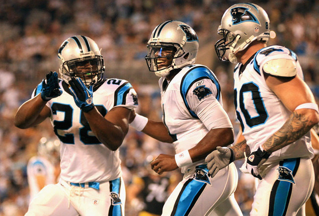 CHARLOTTE, NC - SEPTEMBER 01:  Teammates Jonathan Stewart #28 Cam Newton #1 and Jeremy Shockey #80 of the Carolina Panthers celebrate after Newton's pass for a touchdown to Shockey against the Pittsburgh Steelers during their preseason game at Bank of Ame
