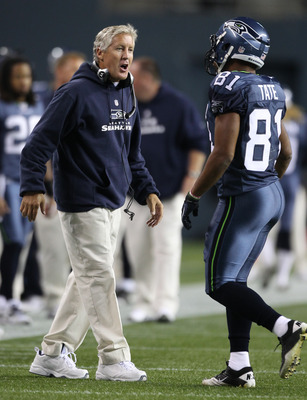SEATTLE, WA - SEPTEMBER 02:  Wide receiver Golden Tate #81 of the Seattle Seahawks is greeted by head coach Pete Carroll during the game against the Oakland Raiders at CenturyLink Field on September 2, 2011 in Seattle, Washington. (Photo by Otto Greule Jr