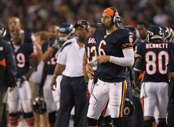CHICAGO, IL - AUGUST 13: Jay Cutler #6 of the Chicago Bears listens to play calls on head phones on the sidelines during a game against the Buffalo Bills during a preseason game at Soldier Field on August 13, 2011 in Chicago, Illinois. The Bears defeated