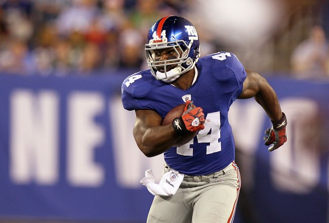 EAST RUTHERFORD, NJ - AUGUST 29:   Ahmad Bradshaw #44 of the New York Giants in action against the New York Jets during their pre season game on August 29, 2011 at MetLife Stadium in East Rutherford, New Jersey.  (Photo by Jim McIsaac/Getty Images)