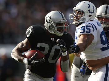 OAKLAND, CA - DECEMBER 26:  Darren McFadden #20 of the Oakland Raiders runs against Fili Moala #95 of the Indianapolis Colts during an NFL game at Oakland-Alameda County Coliseum on December  26, 2010 in Oakland, California.  (Photo by Jed Jacobsohn/Getty