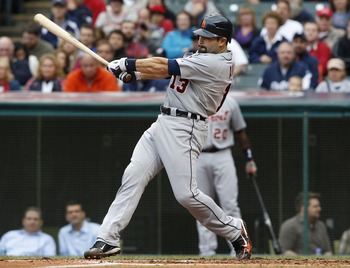CLEVELAND, OH - SEPTEMBER 7:   Alex Avila #13 of the Detroit Tigers hits a sacrifice fly ball against the Cleveland Indians to score Miguel Cabrera #24 (not pictured) during the fourth inning of their game on September 7, 2011 at Progressive Field in Clev