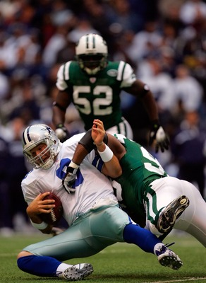 DALLAS - NOVEMBER 22:  Quarterback Tony Romo #9 of the Dallas Cowboys is sacked by Kenyon Coleman #93 of the New York Jets in the first quarter at Texas Stadium on November 22, 2007 in Irving, Texas  (Photo by Ronald Martinez/Getty Images)