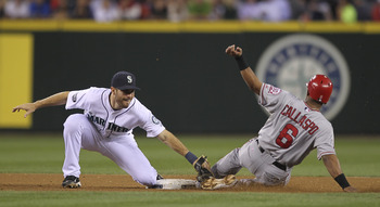 SEATTLE - AUGUST 31:  Alberto Callaspo #6 of the Los Angeles Angels of Anaheim steals second base against Dustin Ackley #13 of the Seattle Mariners at Safeco Field on August 31, 2011 in Seattle, Washington. (Photo by Otto Greule Jr/Getty Images)