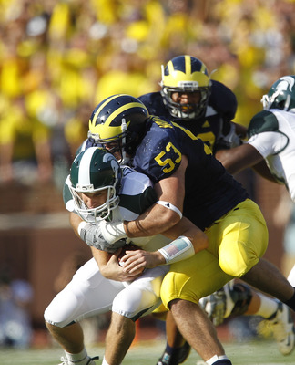 ANN ARBOR, MI - OCTOBER 09: Ryan Van Bergen #53 of the Michigan Wolverines sacks Kirk Cousins #8 of the Michigan State Spartans during the second quarter of the game on October 9, 2010 at Michigan Stadium in Ann Arbor, Michigan. (Photo by Leon Halip/Getty