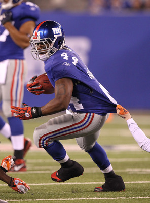 EAST RUTHERFORD, NJ - AUGUST 22: Ahmad Bradshaw #44 of the New York Giants  in action during their pre season game on August 22, 2011 at The New Meadowlands Stadium in East Rutherford, New Jersey.  (Photo by Al Bello/Getty Images)