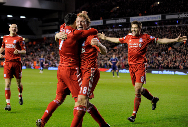 LIVERPOOL, ENGLAND - FEBRUARY 02:  Luis Suarez of Liverpool celebrates with team mates Dirk Kuyt and Steven Gerrard (R) afterscoring his team's second goal during the Barclays Premier League match between Liverpool and Stoke City at Anfield on February 2,