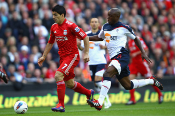 LIVERPOOL, ENGLAND - AUGUST 27:  Nigel Reo-Coker of Bolton Wanderers closes down Luis Suarez of Liverpool during the Barclays Premier League match between Liverpool and Bolton Wanderers at Anfield on August 27, 2011 in Liverpool, England.  (Photo by Clive