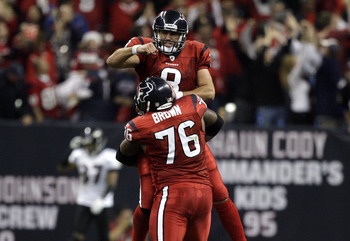 HOUSTON, TX - DECEMBER 13:  Quarterback Matt Schaub #8 of the Houston Texans celebratres with tackle Duane Brown #76 after throwing a 46 yard touchdown pass to Andre Johnson late in the second quarter against the Baltimore Ravens at Reliant Stadium on Dec