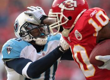 KANSAS CITY, MO - DECEMBER 26:  Alterraun Verner #20 of the Tennessee Titans is stiff-armed by Terrance Copper #10 of the Kansas City Chiefs during the game on December 26, 2010 at Arrowhead Stadium in Kansas City, Missouri.  (Photo by Jamie Squire/Getty