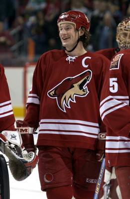 PHOENIX - DECEMBER 31:  Shane Doan #19 of the Phoenix Coyotes smiles en route to defeating the Los Angeles Kings on December 31, 2003 at Glendale Arena in Glendale, Arizona. The Coyotes defeated the Kings 4 - 0. (Photo by Barry Gossage via Getty Images)