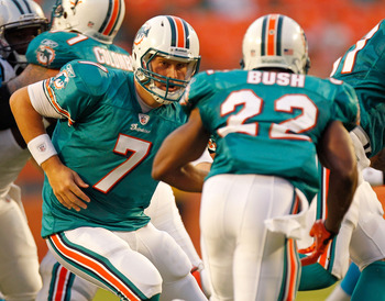 MIAMI GARDENS, FL - AUGUST 19:  Chad Henne #7 of the Miami Dolphins looks to hand off th Reggie Bush #22 during a Preseason NFL game against the Carolina Panthers at Sun Life Stadium on August 19, 2011 in Miami Gardens, Florida.  (Photo by Mike Ehrmann/Ge