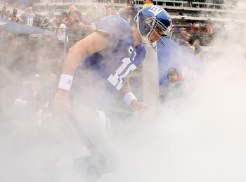 EAST RUTHERFORD, NJ - SEPTEMBER 26:  Eli Manning #10 of the New York Giants comes out of the tunnel during a game against the Tennessee Titans at New Meadowlands Stadium on September 26, 2010 in East Rutherford, New Jersey.  (Photo by Mike Ehrmann/Getty I