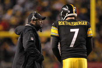 PITTSBURGH, PA - JANUARY 23:  Head coach Mike Tomlin of the Pittsburgh Steelers talks to Ben Roethlisberger #7 as they play the New York Jets in the 2011 AFC Championship game at Heinz Field on January 23, 2011 in Pittsburgh, Pennsylvania. The Steelers wo