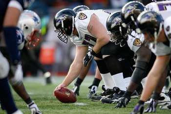 FOXBORO, MA - JANUARY 10:  Matt Birk #77 of the Baltimore Ravens centers the ball against the New England Patriots during the 2010 AFC wild-card playoff game at Gillette Stadium on January 10, 2010 in Foxboro, Massachusetts.  (Photo by Elsa/Getty Images)