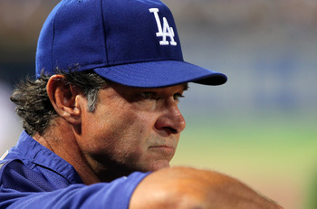 ATLANTA - SEPTEMBER 3: Don Mattingly, manager of the Los Angeles Dodgers, watches the action against the Atlanta Braves on September 3, 2011 at Turner Field in Atlanta, Georgia. The Dodgers beat the Braves 2-1. (Photo by Joe Murphy/Getty Images)