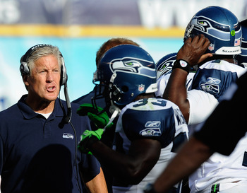 SAN DIEGO, CA - AUGUST 11:  Head coach Pete Carroll of the Seattle Seahawks speaks with quarterback Tarvaris Jackson #7 after a sack during the NFL preseason gameat Qualcomm Stadium on August 11, 2011 in San Diego, California.  (Photo by Kevork Djansezian
