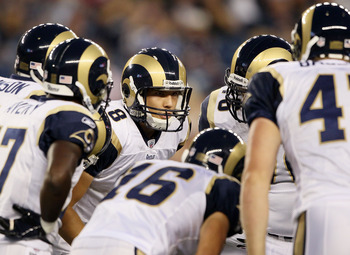 FOXBORO, MA - AUGUST 26:  Sam Bradford #8 of the St. Louis Rams talks to his teammates in the huddle in the first half against the New England Patriots on August 26, 2010 at Gillette Stadium in Foxboro, Massachusetts.  (Photo by Elsa/Getty Images)