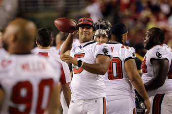 LANDOVER, MD - SEPTEMBER 01: Quarterback Josh Freeman #5 of the Tampa Bay Buccaneers loosens up on the sidelines during the second half of a preseason game against the Washington Redskins at FedExField on September 1, 2011 in Landover, Maryland. The Redsk