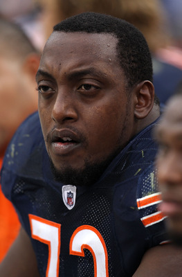 CHICAGO - OCTOBER 24: J'Marcus Webb #73 of the Chicago Bears sits on the bench with teammates at the end of a game against the Washington Redskins at Soldier Field on October 24, 2010 in Chicago, Illinois. The Redskins defeated the Bears 17-14.  (Photo by