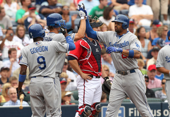 ATLANTA, GA - SEPTEMBER 4: Matt Kemp #27 of the Los Angeles Dodgers is congratulated by Clayton Kershaw #22 and Dee Gordon #9 after hitting a 3-run homerun against the Atlanta Braves on September 4, 2011 at Turner Field in Atlanta, Georgia. (Photo by Joe