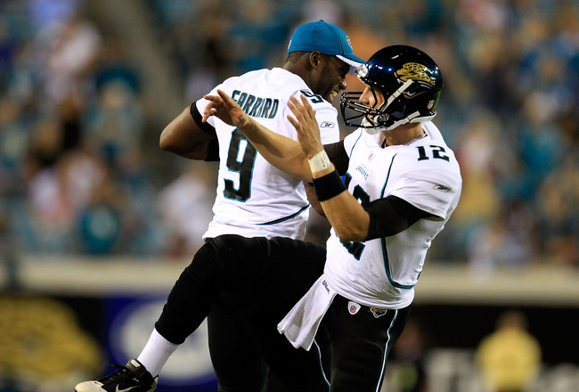 JACKSONVILLE, FL - AUGUST 19:  David Garrard #9 and Luke McCown #12 of the Jacksonville Jaguars celebrate following a touchdown against the Atlanta Falcons during a game at EverBank Field on August 19, 2011 in Jacksonville, Florida.  (Photo by Sam Greenwo