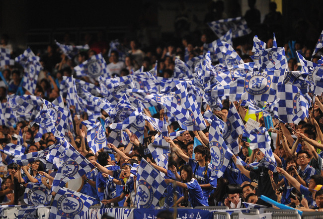 SO KON PO, HONG KONG - JULY 27:  Fervent Chelsea fans react to the team's arrival on the pitch during the Asia Trophy pre-season friendly match between Kitchee and Chelsea at Hong Kong Stadium on July 27, 2011 in So Kon Po, Hong Kong.  (Photo by Raf Sanch