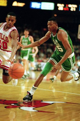CHICAGO - 1993:  Reggie Lewis of the Boston Celtics dribbles the ball during the 1993 NBA game against the Chicago Bulls at the United Center in Chicago, Illinois. NOTE TO USER: User expressly acknowledges and agrees that, by downloading and/or using this