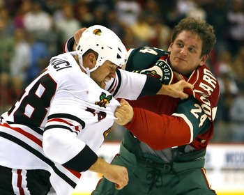 ST. PAUL, MN - OCTOBER 4:  David Koci #48 of the Chicago Blackhawks and Derek Boogaard #24 of the Minnesota Wild fight in the second period of their game October 4, 2007 at the Xcel Energy Center in St. Paul, Minnesota. (Photo by Scott A. Schneider/Getty