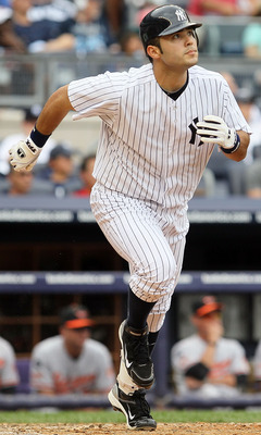 NEW YORK, NY - SEPTEMBER 05:  Jesus Montero #63 of the New York Yankees watches the flight of his fifth-inning home run against the Baltimore Orioles on September 5, 2011 at Yankee Stadium in the Bronx borough of New York City. The blast was the first in