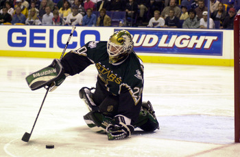 1 May 2001: Goalie Ed Belfour #20 of the Dallas Stars reaches for the puck during game 3 of  Western Conference Semifinals against the St. Louis Blues at the Savvis Center in St. Louis, Missouri.  The Blues won 3-2. DIGITAL IMAGE. Mandatory Credit: Elsa/A