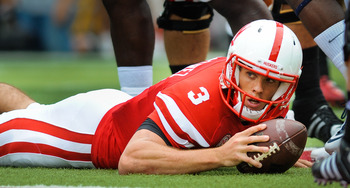 LINCOLN, NE - SEPTEMBER 03: Taylor Martinez #3 of the Nebraska Cornhuskers makes sure he crossed the Chattanooga Mocs goalline during their game at Memorial Stadium September 3, 2011in Lincoln, Nebraska. Nebraska won 40-7. (Photo by Eric Francis/Getty Ima