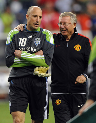 SEATTLE, WA - JULY 20: Goalkeeper Kasey Keller #18 of the Seattle Sounders FC speaks with head coach Sir Alex Ferguson of Manchester United as they walk off the field after the game at CenturyLink Field on July 20, 2011 in Seattle, Washington. Manchester