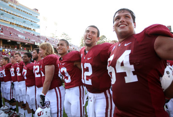 STANFORD, CA - SEPTEMBER 03:  Andrew Luck #12 of the Stanford Cardinal celebrates with teammates after they beat the San Jose State Spartans at Stanford Stadium on September 3, 2011 in Stanford, California.  (Photo by Ezra Shaw/Getty Images)