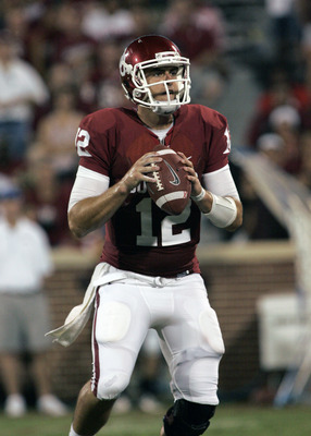 NORMAN, OK - SEPTEMBER 3:  Quarterback Landry Jones #12 of the Oklahoma Sooners prepares to throw in the second half against the Tulsa Hurricanes September 3, 2011 at Gaylord Family-Oklahoma Memorial Stadium in Norman, Oklahoma.  Oklahoma defeated Tulsa 4