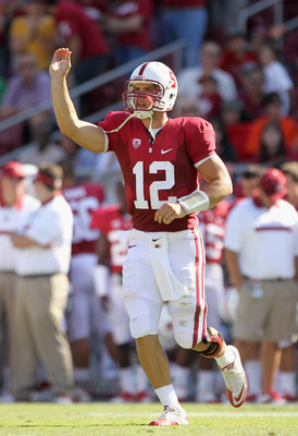 STANFORD, CA - SEPTEMBER 03:  Andrew Luck #12 of the Stanford Cardinal runs on to the field during their game against the San Jose State Spartans at Stanford Stadium on September 3, 2011 in Stanford, California.  (Photo by Ezra Shaw/Getty Images)