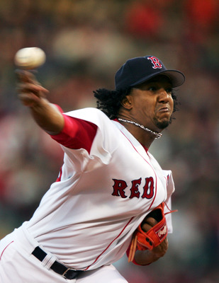 BOSTON - OCTOBER 18:  Pitcher Pedro Martinez #35 of the Boston Red Sox delivers against the New York Yankees in the first inning during game five of the American League Championship Series on October 18, 2004 at Fenway Park in Boston, Massachusetts.  (Pho