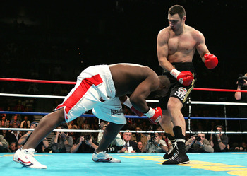 LAS VEGAS, NV - DECEMBER 11: Vitali Klitschko of Ukraine knocks down Danny Williams of England in the first round on his way to winning by TKO at 1:26 of the Eight round and retain his WBC Heavyweight Title on December 11, 2004 at The Mandalay Bay in Las