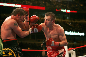 CHICAGO - MAY 21:  Tomasz Adamek (R) hits Paul Briggs (L) in the WBC Light Heavyweight Championship on May 21, 2005 at the United Center in Chicago, Illinois.  Adamek won the bout by majority decision.  (Photo by Jonathan Daniel/Getty Images)