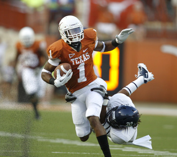 AUSTIN, TX - SEPTEMBER 3:  Wide Receiver Mike Davis #1 of the Texas Longhorns is tackled by cornerback Chris Jammer #38 of the Rice Owls after a long pass reception in the first quarter on September 3, 2011 at Darrell K. Royal-Texas Memorial Stadium in Au