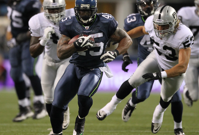 SEATTLE, WA - SEPTEMBER 02:  Running back Thomas Clayton #45 of the Seattle Seahawks rushes against the Oakland Raiders at CenturyLink Field on September 2, 2011 in Seattle, Washington. (Photo by Otto Greule Jr/Getty Images)