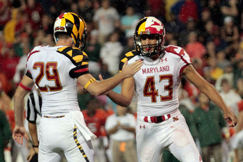 COLLEGE PARK, MD - SEPTEMBER 05: Holder Michael Tart #29 celebrates a late fourth quarter field goal with kicker Nick Ferrara #43 of the Maryland Terrapins against the Miami Hurricanes at Byrd Stadium on September 5, 2011 in College Park, Maryland. Maryla