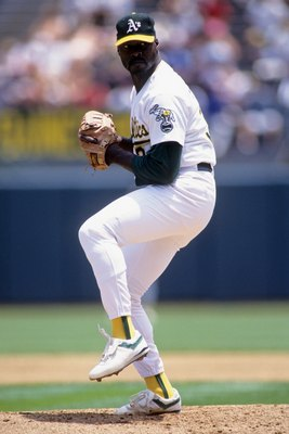 OAKLAND, CA - JUNE 24:  Dave Stewart #34 of the Oakland Athletics pitches during an MLB game against the Seattle Mariners on June 24, 1992 at Oakland-Alameda County Coliseum in Oakland, California. (Photo by Otto Greule Jr./Getty Images)