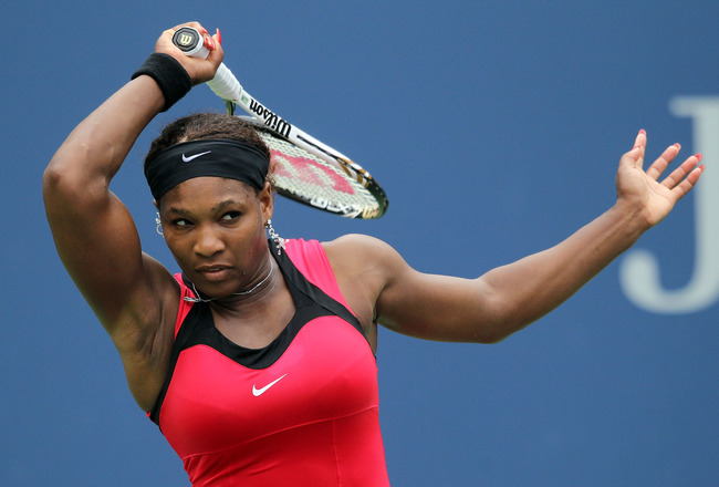 NEW YORK, NY - SEPTEMBER 05:  Serena Williams of the United States returns a shot against Ana Ivanovic of Serbia during Day Eight of the 2011 US Open at the USTA Billie Jean King National Tennis Center on September 5, 2011 in the Flushing neighborhood of