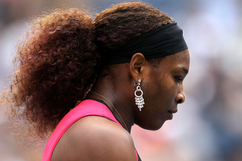NEW YORK, NY - SEPTEMBER 05:  Serena Williams of the United States looks on against Ana Ivanovic of Serbia during Day Eight of the 2011 US Open at the USTA Billie Jean King National Tennis Center on September 5, 2011 in the Flushing neighborhood of the Qu