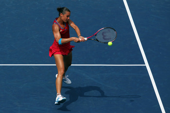NEW YORK, NY - SEPTEMBER 04:  Flavia Pennetta of Italy returns a shot against Shuai Peng of China during Day Seven of the 2011 US Open at the USTA Billie Jean King National Tennis Center on September 4, 2011 in the Flushing neighborhood of the Queens boro