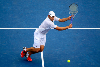 NEW YORK, NY - SEPTEMBER 04:  Andy Roddick of the United States returns a shot against Julien Benneteau of France during Day Seven of the 2011 US Open at the USTA Billie Jean King National Tennis Center on September 4, 2011 in the Flushing neighborhood of