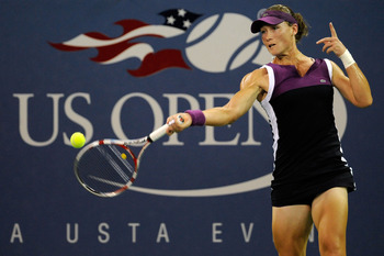 NEW YORK, NY - SEPTEMBER 04:  Samantha Stosur of Australia returns a shot against Maria Kirilenko of Russia during Day Seven of the 2011 US Open at the USTA Billie Jean King National Tennis Center on September 4, 2011 in the Flushing neighborhood of the Q
