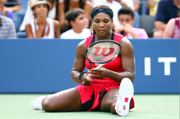 NEW YORK, NY - SEPTEMBER 03:  Serena Williams of the United States looks at her racket after losing balance against Victoria Azarenka of Belarus during Day Six of the 2011 US Open at the USTA Billie Jean King National Tennis Center on September 3, 2011 in